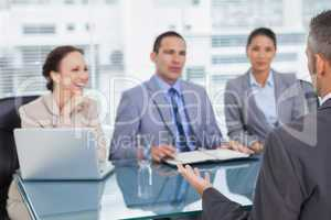 Work team interviewing experienced man