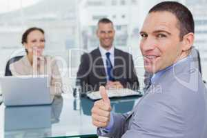 Applicant giving thumb up after obtaining the job