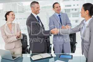 Smiling future workmates shaking hands