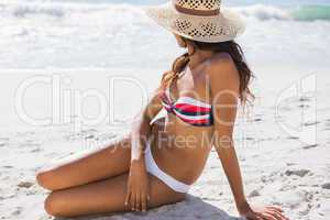 Young sexy woman wearing straw hat relaxing
