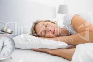 Blonde woman sleeping in bed peacefully