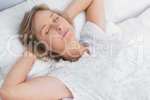 Woman sleeping peacefully in bed
