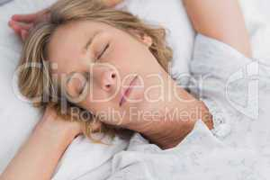 Woman sleeping peacefully in bed close up