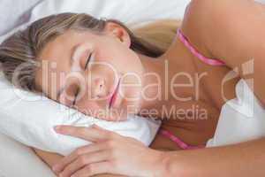 Beautiful blonde sleeping peacefully in bed