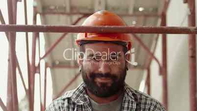 1of11 Young man at work in construction site, manual worker