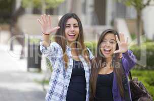 Mixed Race Female Students Waving Carrying Backpacks on School C