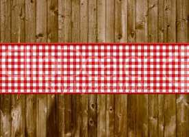 Braune Bretter-Holzwand mit rot-weißem Streifen