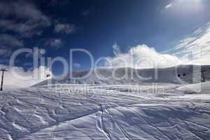 off-piste ski slope and gondola lift
