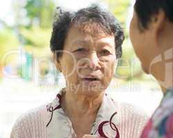 Sadness senior woman telling sad story