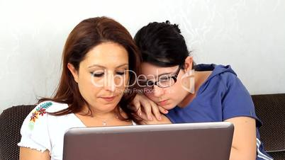 Mother and daughter with notebook together