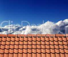 roof tiles and sunny sky with clouds