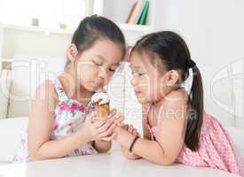 Children eating ice cream cone
