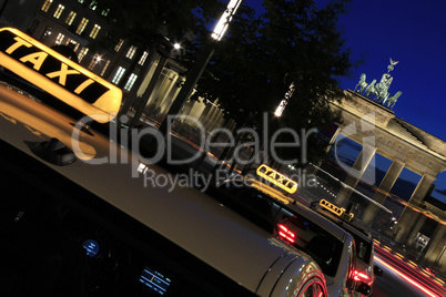 Berlin - Brandenburger Tor w Taxis and Tourists at blue hour with Light Rays