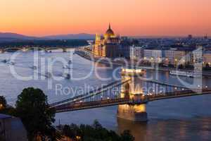 budapest cityscape sunset with chain bridge and parliament build