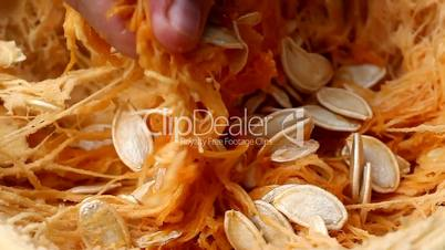 Taking the seeds out of the pumpkin