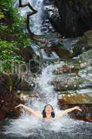 woman in wild waterfall
