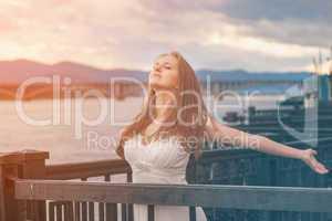 Free happy young girl enjoying nature