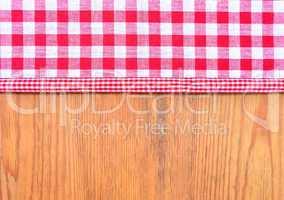 rot kariter Stoff Rustikaler Holzhintergrund