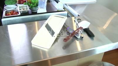 chef cutting garlic in a professional kitchen