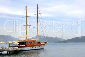 sail yacht near beach on turkish resort, marmaris, turkey