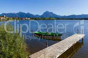 Alps panorama with lake, runway and boat