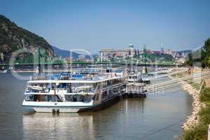 cruise ships docked on danube river shore in budapest