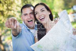 Mixed Race Couple Looking Over Map Outside Together
