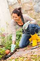 Smiling woman plant flowerbed hobby garden autumn