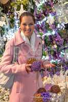 Woman in festive mood buying Christmas ornaments