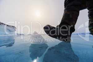 frozen lake baikal and human leg