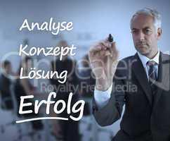 Elegant businessman writing marketing terms in german