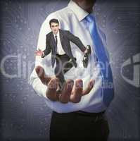 Classy manager holding small businessman in his hand