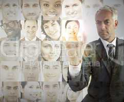 Serious businessman choosing future employees