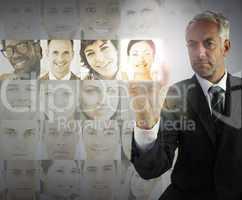 Stern businessman choosing future employees