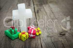 religious cross with presents