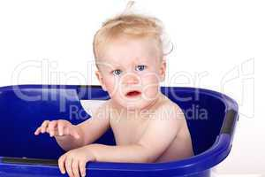 Toddler sitting in the bathtub