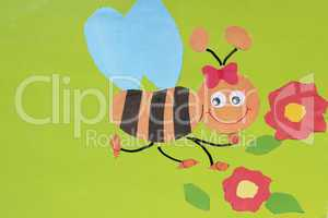 toy bee made by children's hands from paper