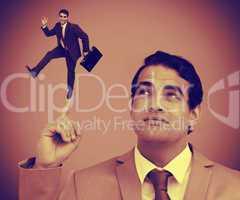 Businessman showing shrunk colleague on his finger