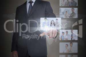 Classy businessman selecting digital interface