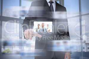 Classy businessman in bright office presenting digital interface