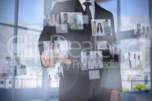Stylish businessman presenting coworkers pictures