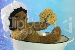 Teddybär in der Badewanne