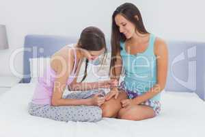 Girl painting her friends nails