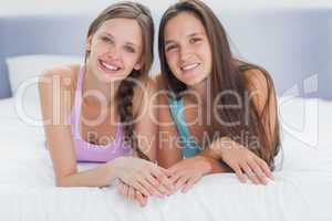 Girls lying in bed