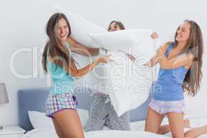 Friends having pillow fight