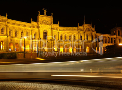 munich - maximilianeum at night with rays from a street car