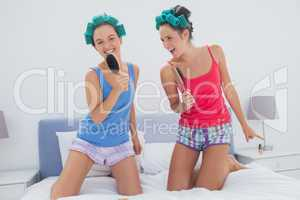 Girls having fun wearing pajama and hair rollers