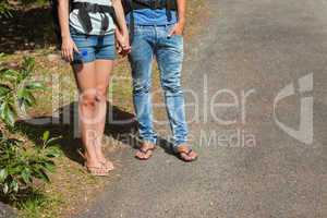 Legs of couple going for a trek together