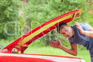Lost handsome man checking his car engine