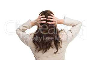 Young classy businesswoman with hands on head standing back to c